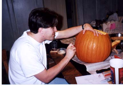 Steve carving a pumpkin