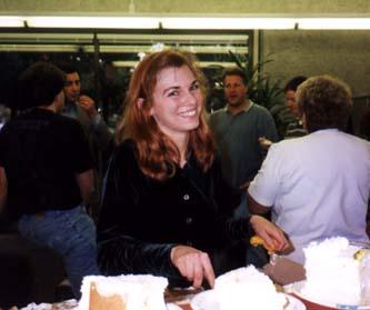 Anne cutting the big cake