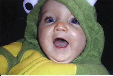 Ian in his frog Halloween costume at 8 and a half months