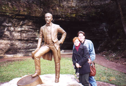 Annd and Steve with statue of Jack Daniel