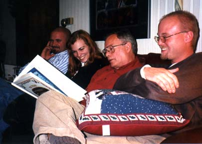 Geoff, Anne, Dad, and Greg reading 'Twas the NIght Before Christmas