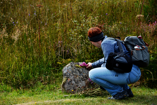 Anne at Mixed Clans grave marker at Culloden Battlefield