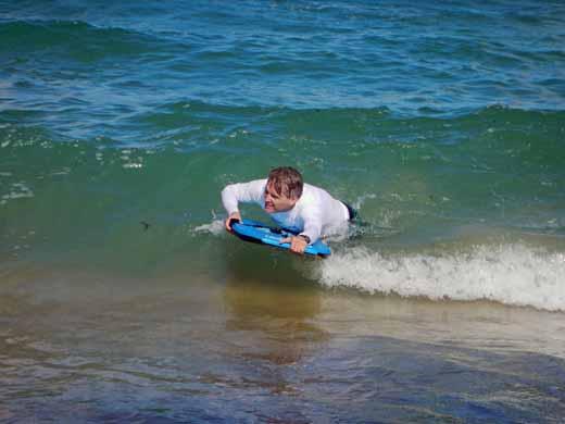 Steve riding a wave