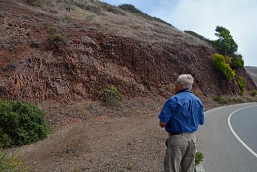 Dad looking at a rock face